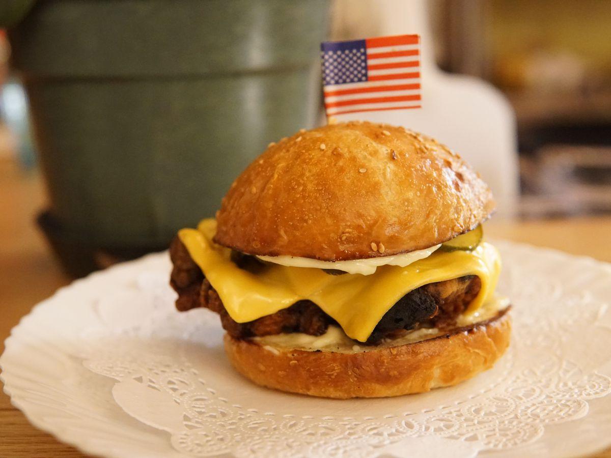 Crunchy fried chicken, Duke's mayo, American cheese, bread & butter pickles on a buttermilk bun