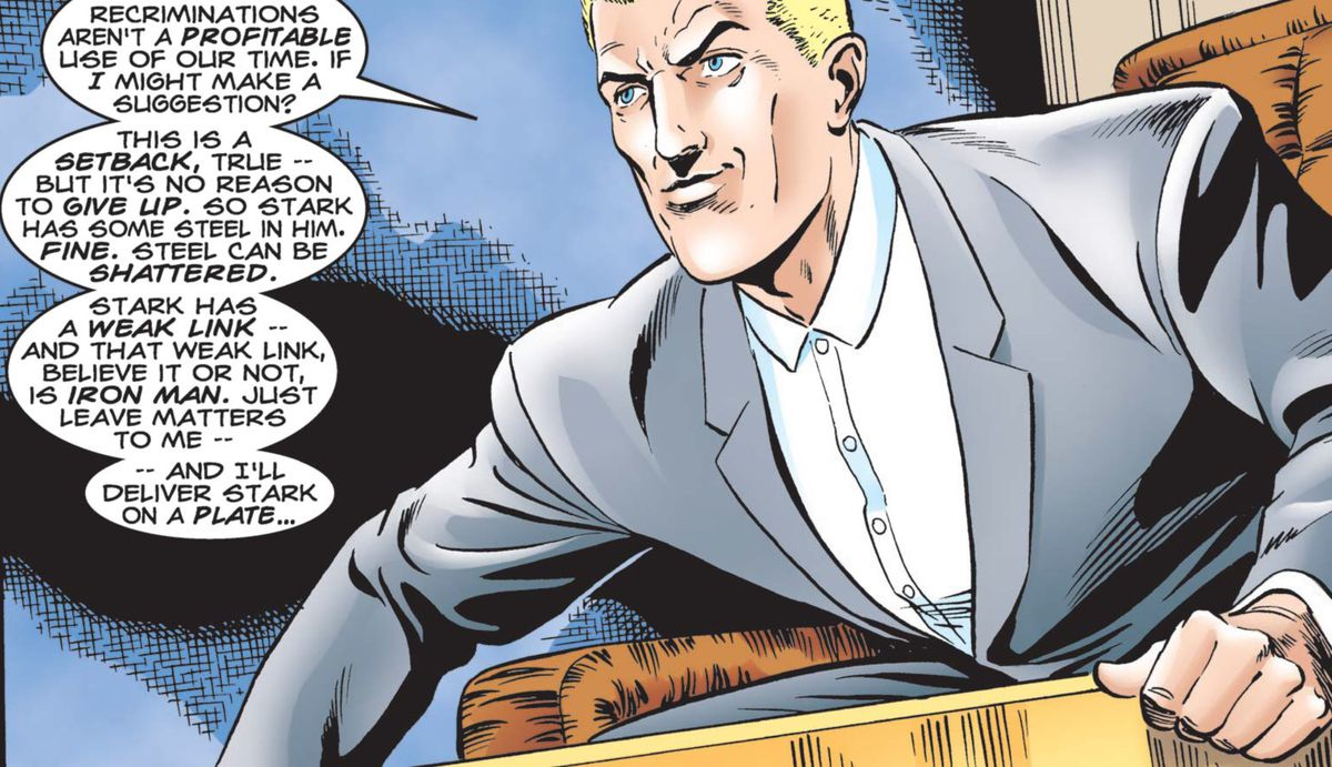 Simon Krieger leans forward in his big business boardroom chair and smarms evilly about Tony Stark in Iron Man: The Iron Age #1, Marvel Comics  (1998).