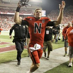 Nebraska quarterback Taylor Martinez celebrates following an NCAA college football game against Wisconsin, in Lincoln, Neb., Saturday, Sept. 29, 2012. Martinez guided four straight scoring drives against a tiring Wisconsin defense in the second half to lead No. 22 Nebraska's comeback from a 17-point deficit to defeat the Badgers 30-27.