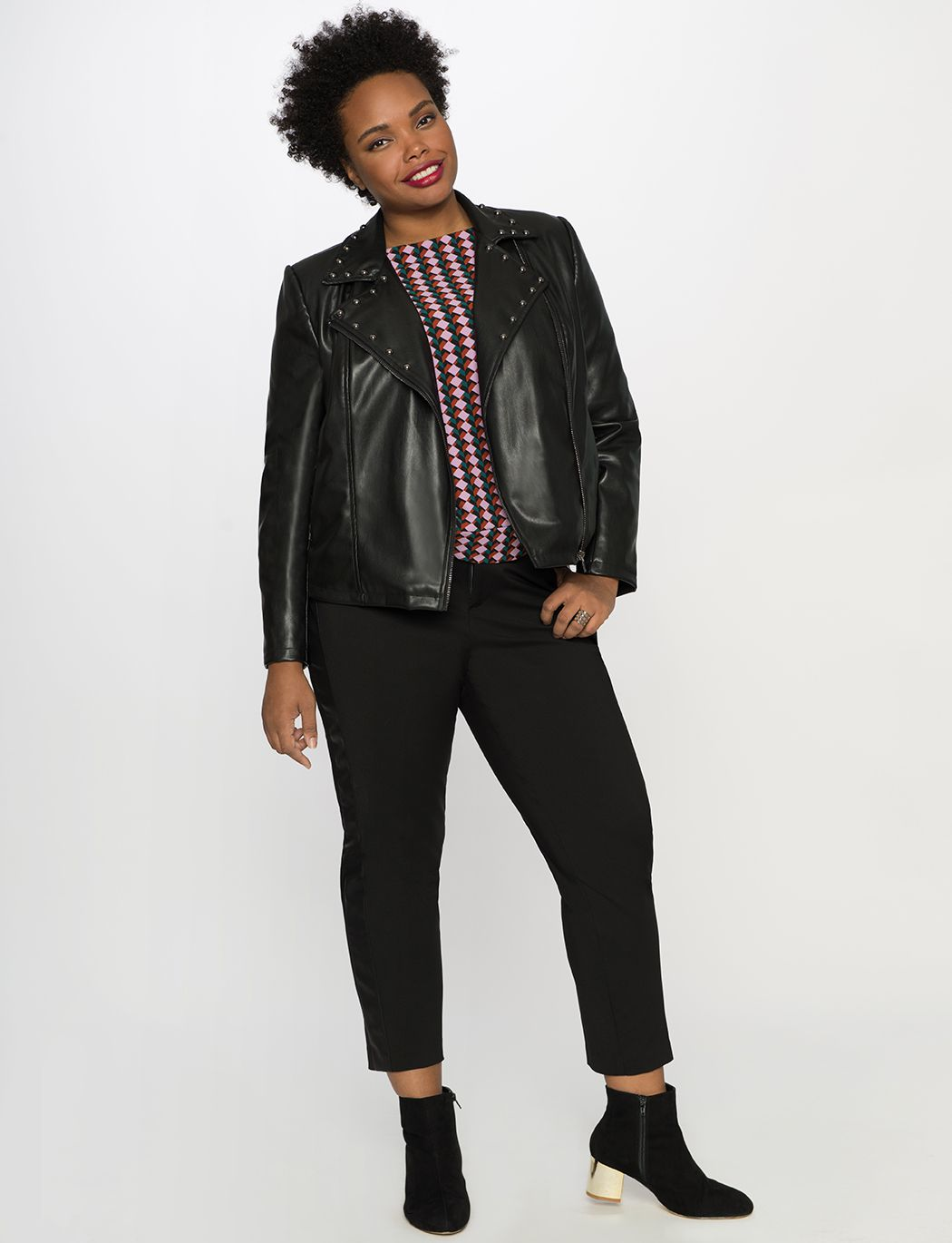 A model in black pants and a leather jacket