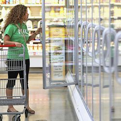 In this Sept. 20, 2012 photo, Sycamore, Ill., resident Katie Myers, 25, shops for gluten-free products at a grocery store's health market section in Sycamore. Myers has been eating gluten-free for about six years.
