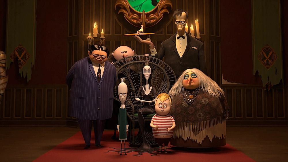 Gomez, Fester, Wednesday, Morticia, Pugsley, Lurch, and Grandmama Addams in The Addams Family 2