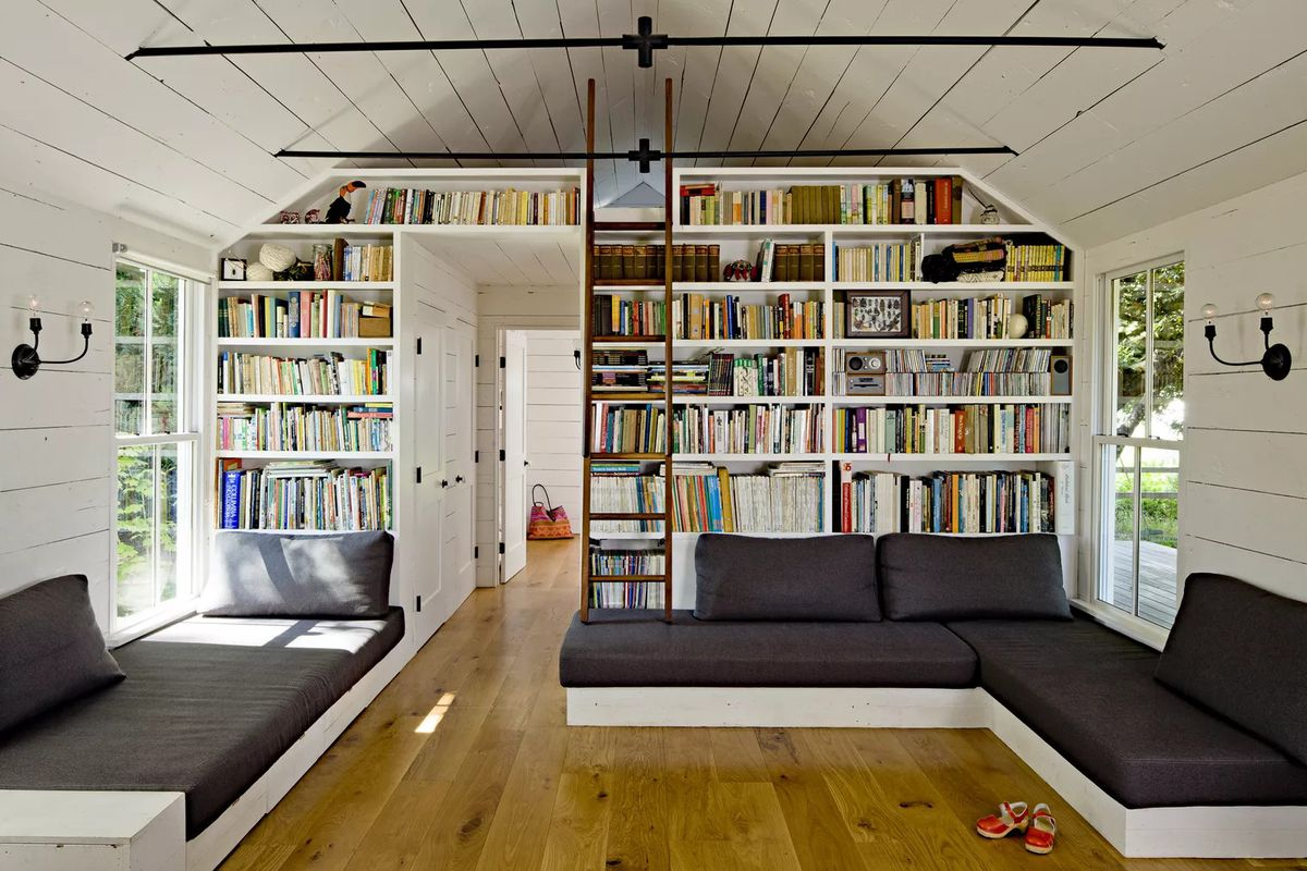 Small home with built-in bookcases and sleeping loft.