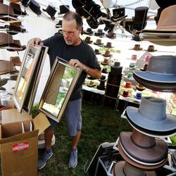 Artists work to get set up for the Utah Arts Festival in Salt Lake City on Wednesday, June 21, 2017.