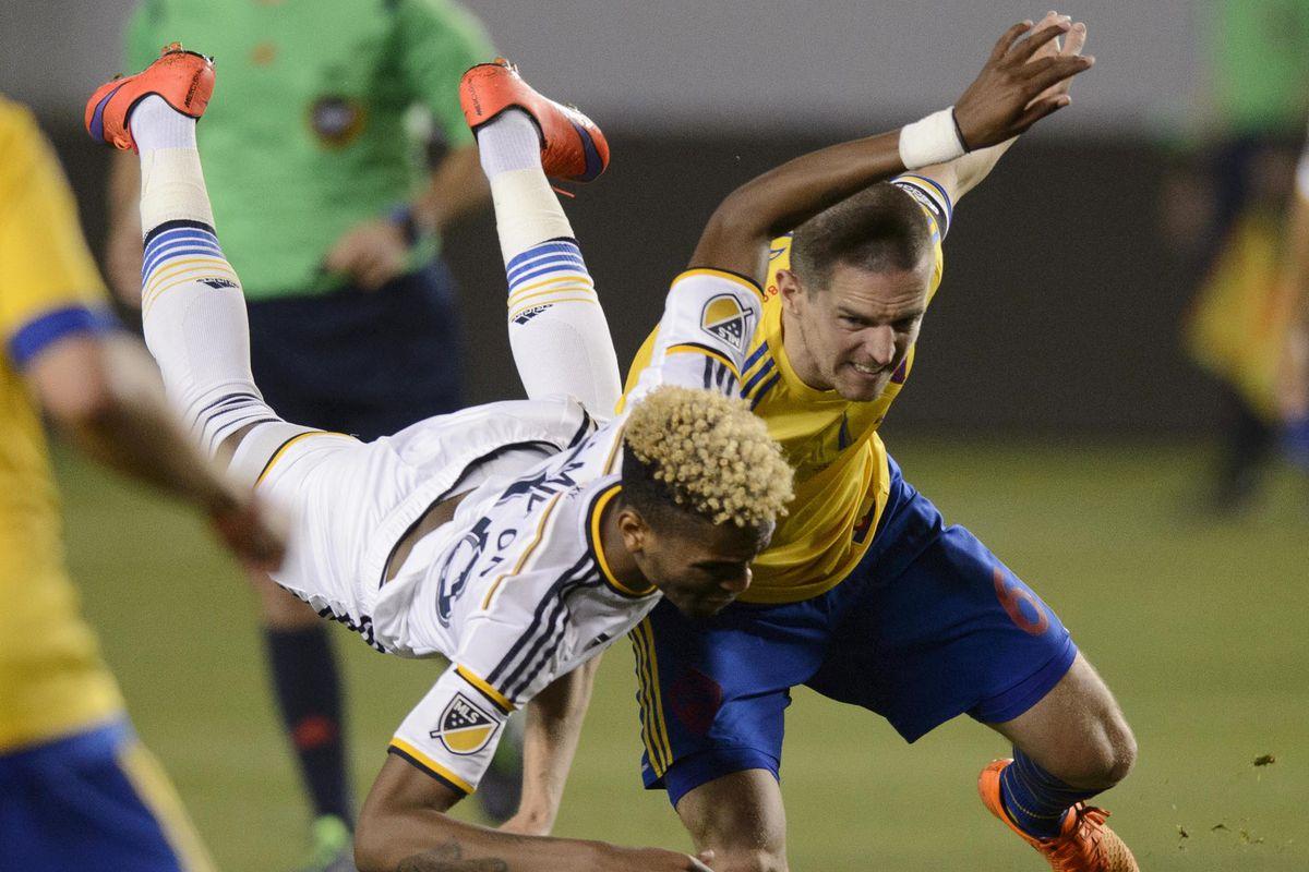 Bradford Jamieson falls over Cronin in the second half in Los Angeles.