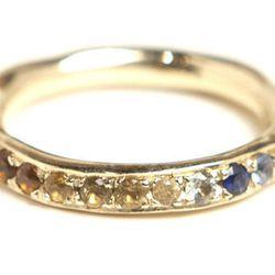 "<b>Kathryn Bentley</b> 14K gold eternity rainbow sapphire organic ring, $1800 at <a href=""http://www.dreamcollective.com/collections/kathryn-bentley-rings/products/eternity-rainbow-sapphire-organic-ring""target=""_blank"">Dream Collective</a>."