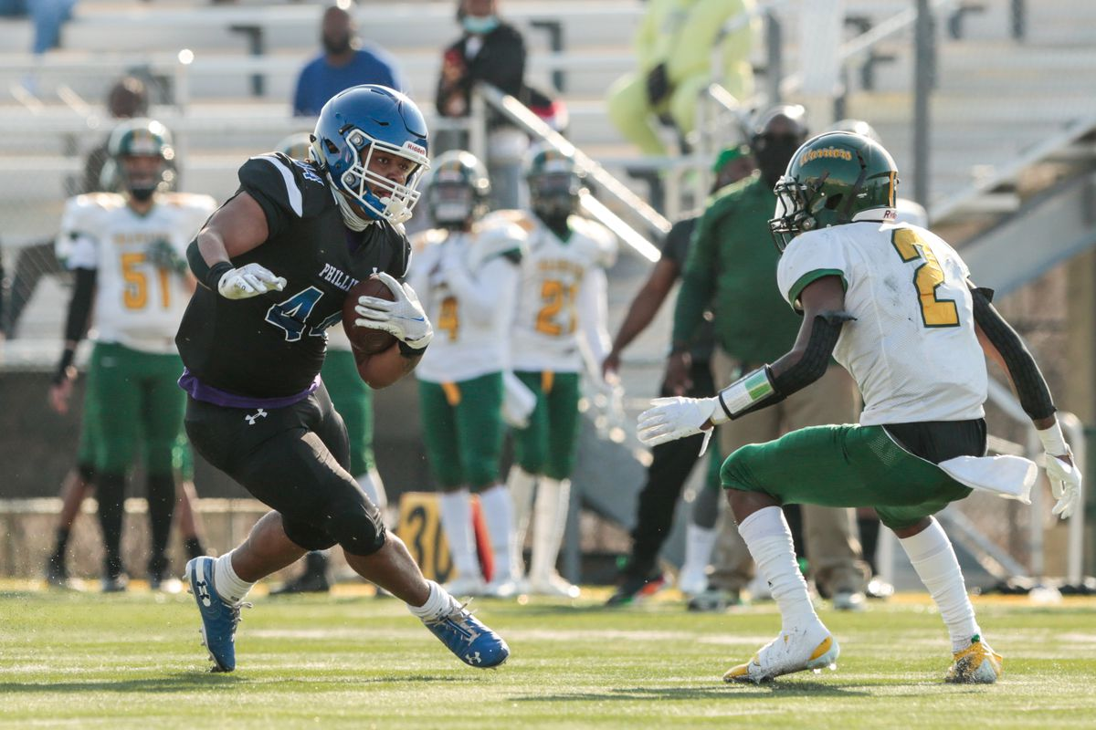 Phillips' Jamel Britt (44) moves to evade Westinghouse's Kejuan Pitts (2).