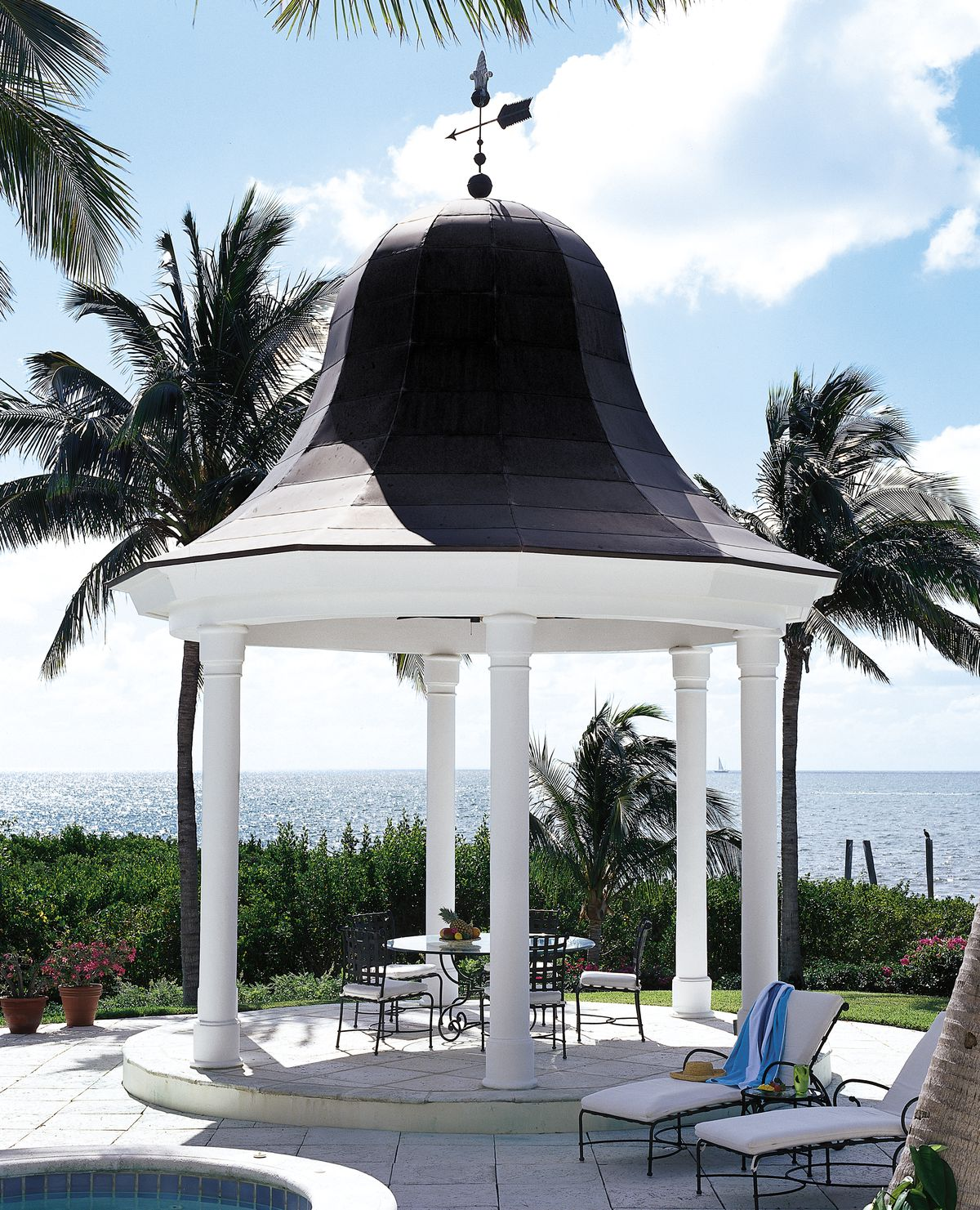 <p>At a home in Key Largo, Florida, a round gazebo with a bell-shaped copper roof provides poolside shelter from the sun — and a cool vantage point for viewing the ocean beyond.</p>