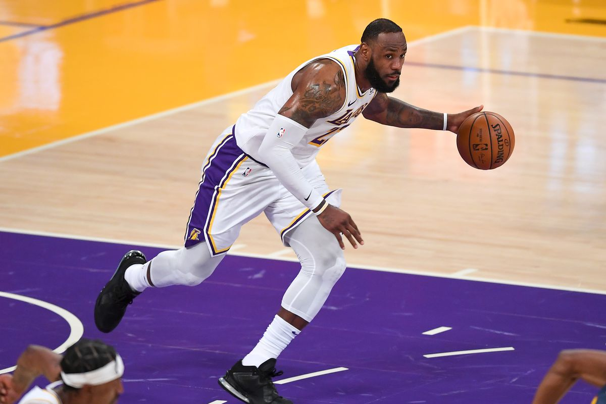 Los Angeles Lakers forward LeBron James (23) takes the ball down court in the second half of the game against the Golden State Warriors at Staples Center. Mandatory Credit: Jayne Kamin-Oncea