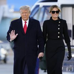 President Donald Trump and first lady Melania Trump arrive on Marine One before boarding Air Force One at Andrews Air Force Base, Md., Wednesday, Jan. 20, 2021.