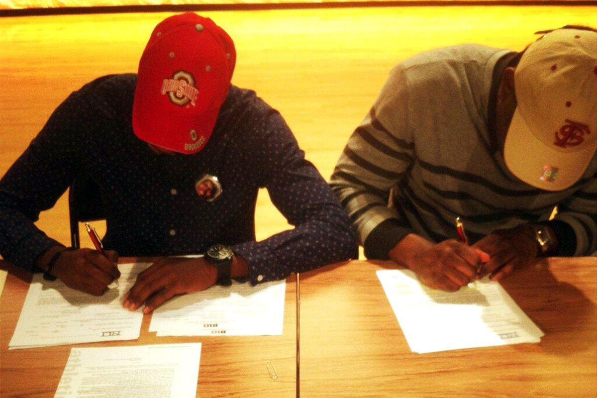 Clark (left) makes his status as a Buckeye official.