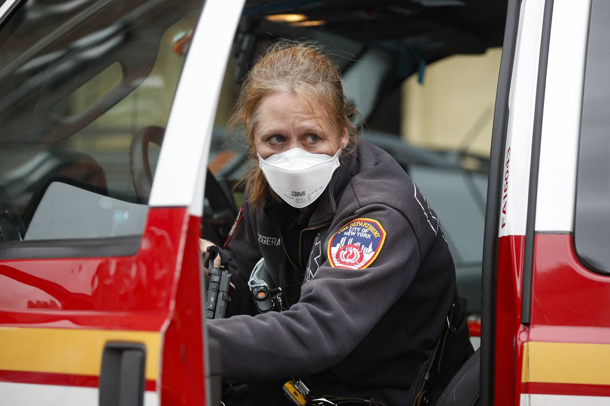 An FDNY medical worker wears personal protective equipment outside a COVID-19 testing site at Elmhurst Hospital Center on Wednesday in New York.