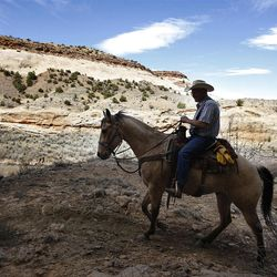 Rick Stott rides down the Little Grand Canyon of the San Rafael Swell  Saturday, April 2, 2011, in the San Rafael Swell in Central Utah.
