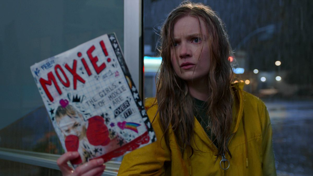 vivian angrily holding up a zine