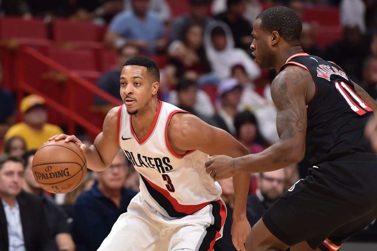 Portland Trail Blazers guard C.J. McCollum is defended by Miami Heat guard Dion Waiters during the second half at American Airlines Arena.