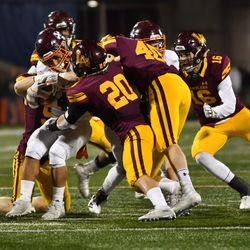 Brother Rice's defense stops Jessie Plunkett (4). Worsom Robinson/For the Sun-Times.
