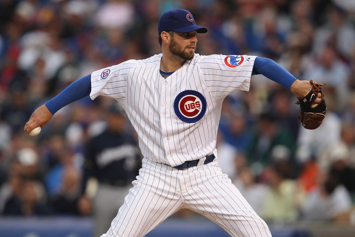 Starting pitcher Randy Wells of the Chicago Cubs delivers the ball against the Milwaukee Brewers at Wrigley Field on June 14, 2011 in Chicago, Illinois.  (Photo by Jonathan Daniel/Getty Images)