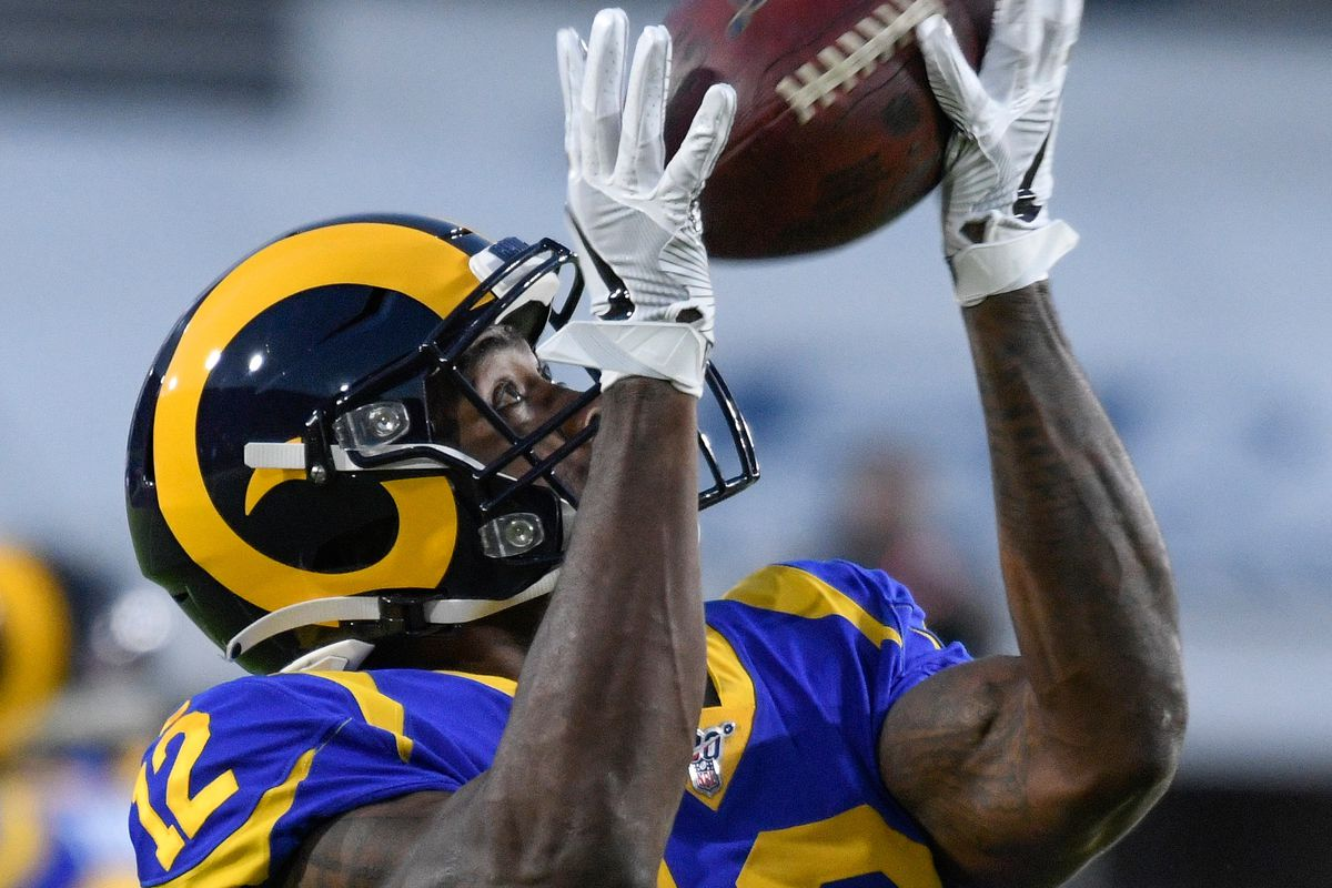 Los Angeles Rams wide receiver Brandin Cooks hauls in a pass during pregame warmups before the Rams play the Seattle Seahawks at Los Angeles Memorial Coliseum.