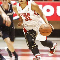 Utah's Ciera Dunbar pushes the ball up court as Utah and Utah State play Nov. 27, 2012, in the Huntsman Center. Utah won 92-64.