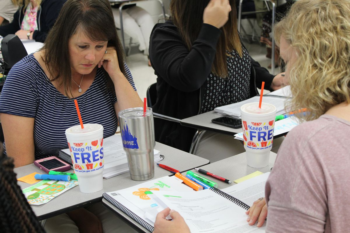 In a teacher training session on Wednesday, kindergarten teachers highlight the three dimensions of three-dimensional modeling, a key part of new state science standards.