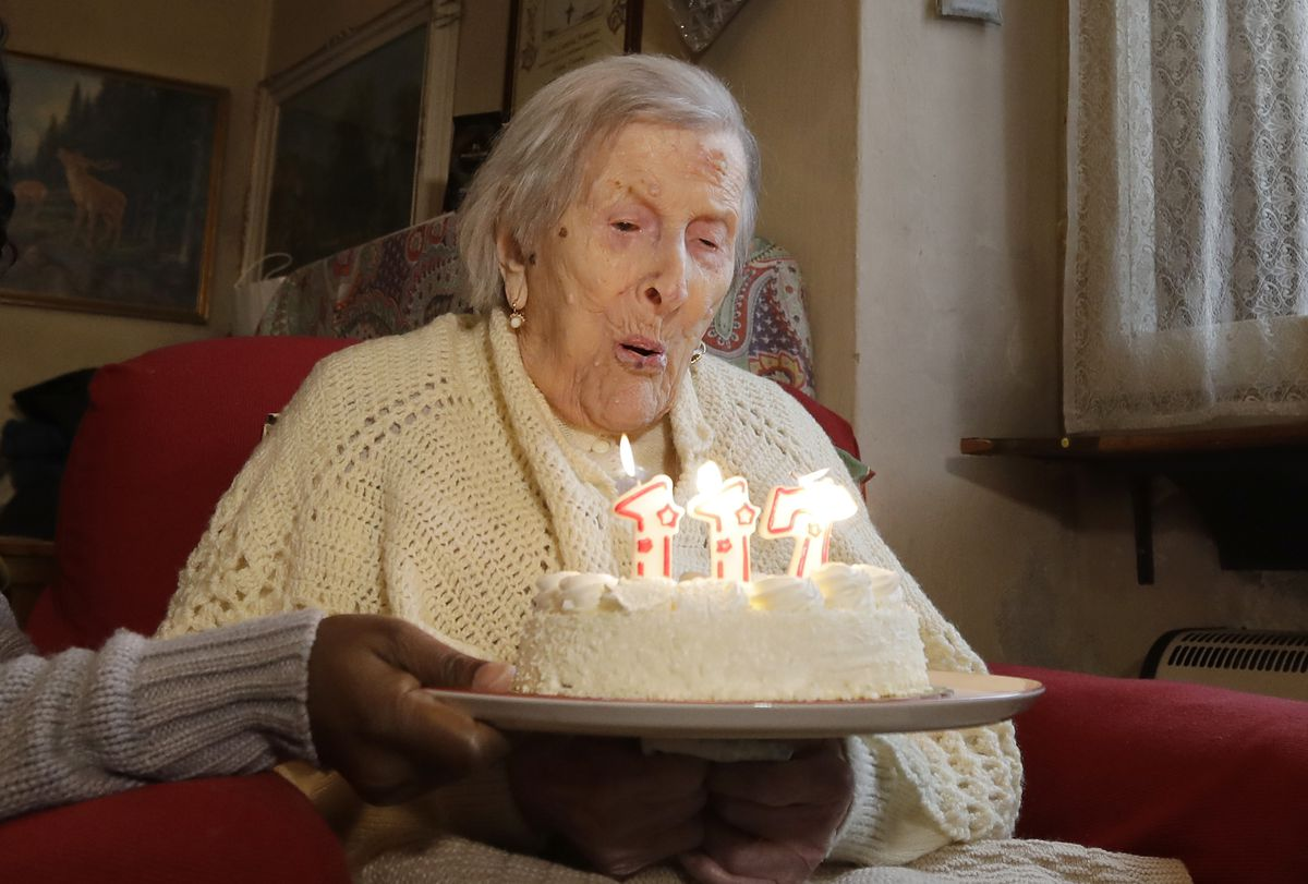 Emma Morano of Italy is shown celebrating her 117th birthday last year. Dr. Carlo Bava told The Associated Press by telephone that Morano's caretaker called him to say the woman had passed away Saturday afternoon while sitting in an armchair in her home.