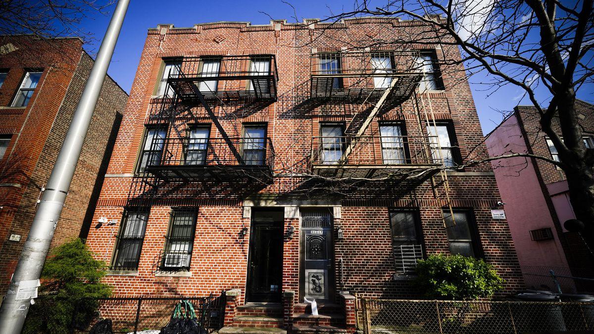 A three-story brick apartment building.