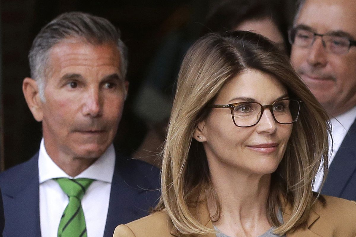 FILE - In this April 3, 2019 file photo, actress Lori Loughlin, front, and her husband, clothing designer Mossimo Giannulli, left, depart federal court in Boston after facing charges in a nationwide college admissions bribery scandal. On Tuesday, April 9,