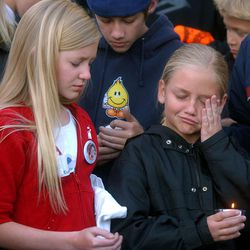 13-year old Tori Dumke (left) and 10-year old Cessile Smart attend the Candlelight vigil at Liberty Park for their 14-year old cousin Elizabeth Smart, who was kidnapped.