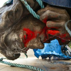 """In this photograph made available by Bristol City Council, the statue of Edward Colston is placed in the back of a truck after being recovered from the harbor in Bristol, Thursday June 11, 2020, after it was toppled by anti-racism protesters on Sunday. The council says it has been taken to a """"secure location"""" and will end up in a museum. Colston built a fortune transporting enslaved Africans across the Atlantic, and left most of his money to charity."""