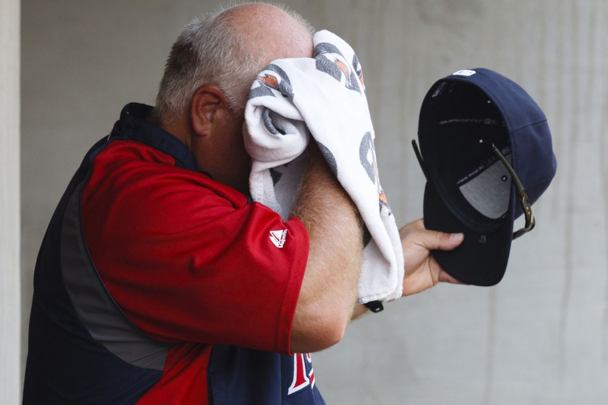 July 5, 2012; Detroit, MI, USA; Minnesota Twins manager Ron Gardenhire (35) towels off during the fourth inning against the Detroit Tigers at Comerica Park. Mandatory Credit: Rick Osentoski-US PRESSWIRE