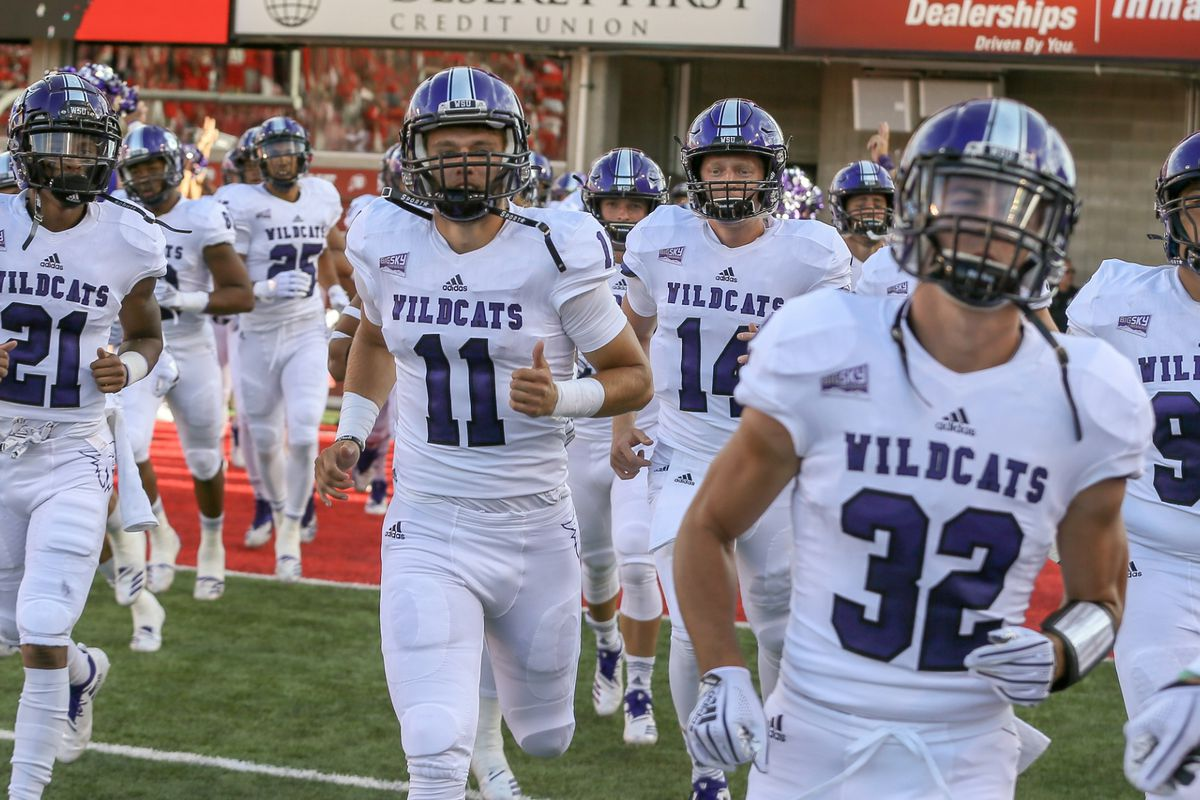 FILE: Weber State runs onto the field at Rice-Eccles Stadium.