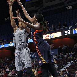 Connecticut Sun's Jonquel Jones (35) blocks the shot of San Antonio Stars' Shamela Hampton (3).