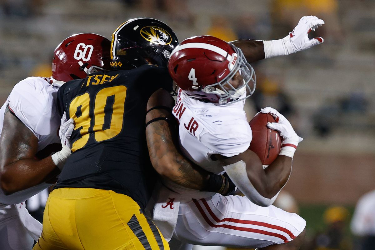 Brian Robinson Jr. of the Alabama Crimson Tide gets tackled by Markell Utsey of the Missouri Tigers on September 26, 2020 at Memorial Stadium in Columbia, Missouri.