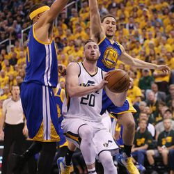 Utah Jazz forward Gordon Hayward (20) drives on Golden State Warriors center JaVale McGee (1) during the second round of the NBA playoffs on Saturday, May 6, 2017.