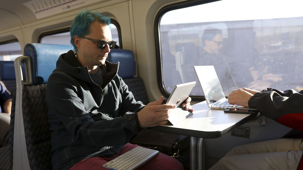Rob Weidmann works while on the FrontRunner, commuting to work in Lehi, on Thursday, Nov. 8, 2018.