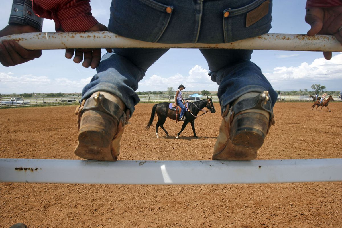Roman McCabe (cq) sits on a fence surrounding the Ft. Duchesne rodeo grounds before competing in the saddle bronc competition in the Ft. Duchesne rodeo Sunday July 2, 2006. The McCabe's traveled from Tuba City, AZ on the Navajo Nation to participate in the rodeo. Roman ended up winning the event. Keith Johnson/Deseret Morning News