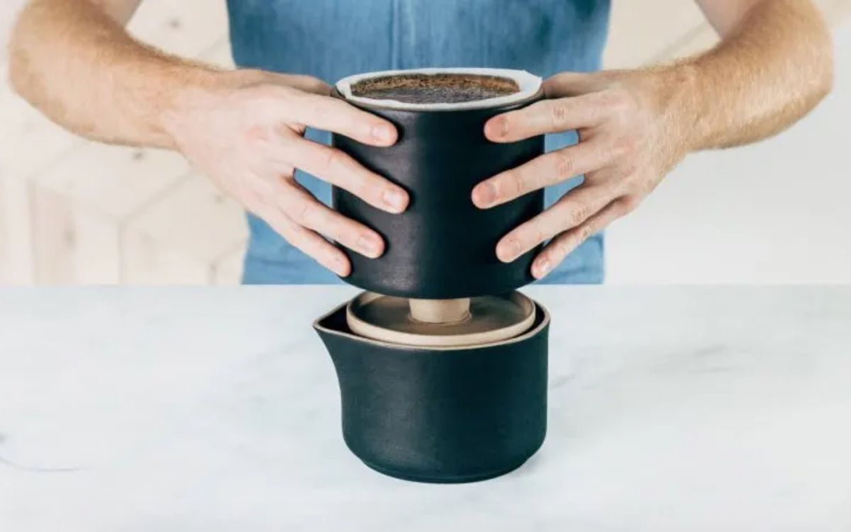 Man stacking ceramic vessels on each other