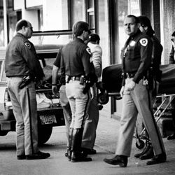 The body of Steven Christensen is removed from the Judge Building in Salt Lake City in October 1986.