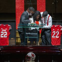 Aaron Lowe's mother, center, Donna Sterns, is consoled by her sons and Aaron's brothers Adron, left, and Erin, right, during a funeral service for Aaron at Family Cathedral of Praise on Monday, Oct. 11, 2021, in Mesquite, Texas. Lowe, a student and football player at the University of Utah, was was shot and killed on Sept. 26 at a postgame party.