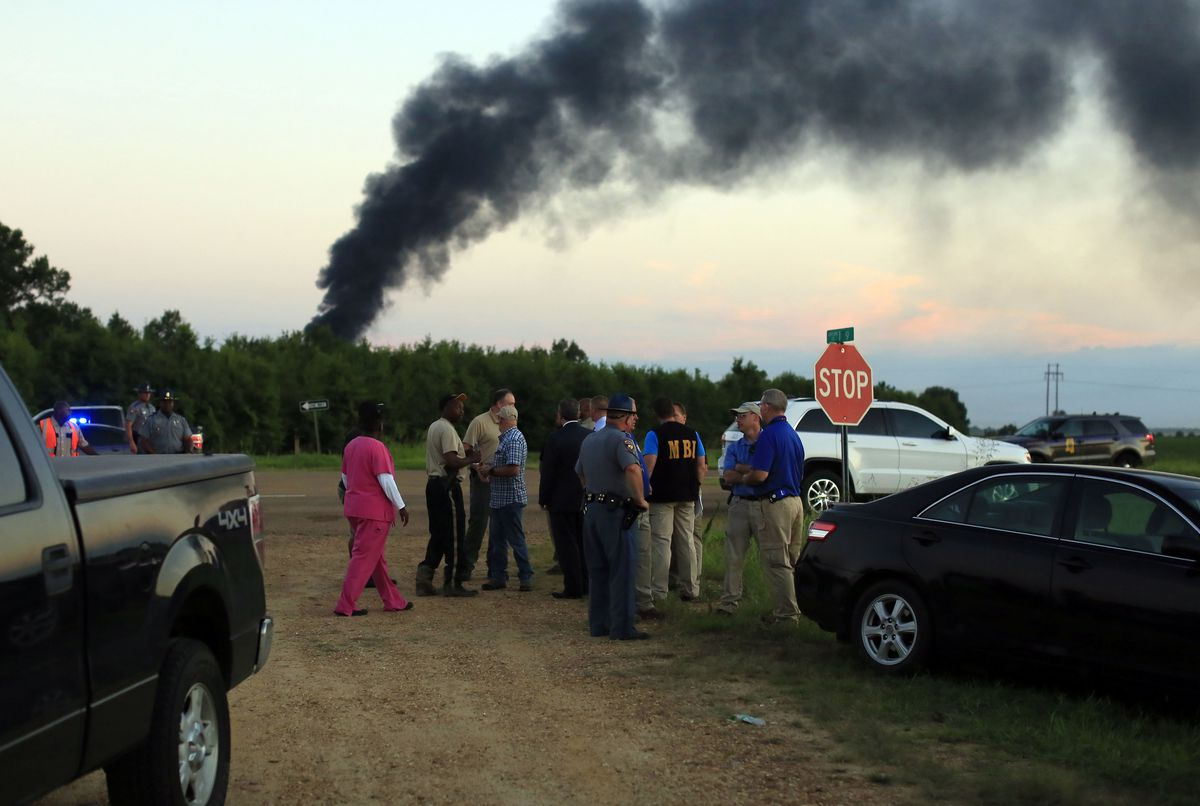 Emergency officials respond to the site of a military plane crash near Itta Bena, Miss. on Monday. | Elijah Baylis/The Clarion-Ledger, distributed by the Associated Press