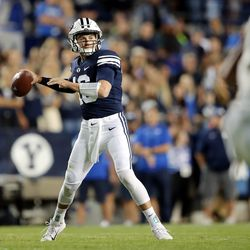 Brigham Young Cougars quarterback Baylor Romney (16) looks to make a throw as BYU and USF play a college football game at LaVell Edwards Stadium in Provo on Saturday, Sept. 25, 2021.