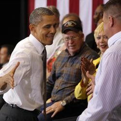 President Barack Obama reaches out to shake hands with Lorain County Community College student Bronson Harwood after speaking at the college in Elyria, Ohio, Wednesday, April 18, 2012.
