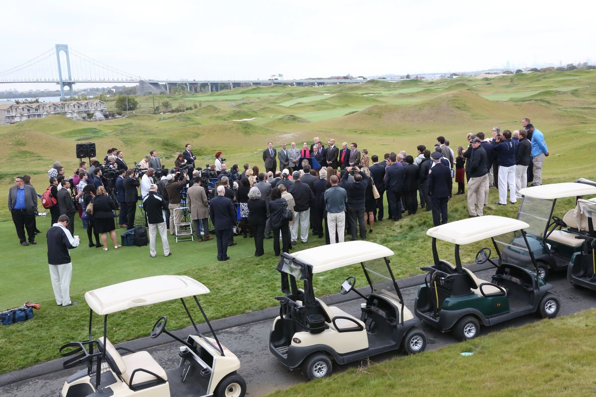 Former Mayor Michael Bloomberg announces with Donald Trump the opening of the Trump Golf Links in The Bronx, Oct. 16, 2013.