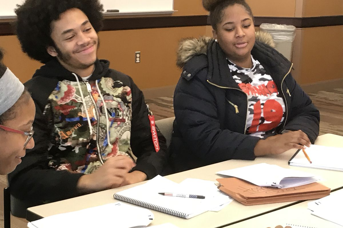 Myles Reed, a senior at Henry Ford Academy: School for Creative Studies, left, hopes to improve his SAT score so he can earn free college tuition to a four-year university.