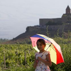 An Armenian girl leaves after waiting to see Pope Francis during a ceremony at the Khor Virap's monastery near Ararat's mountain, Armenia, on June 26, 2016.