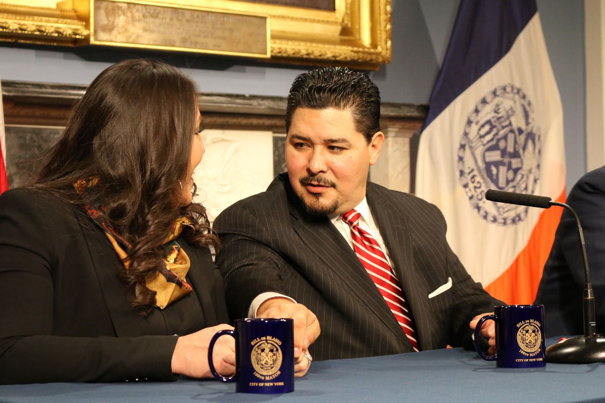 Houston Independent School District Superintendent Richard Carranza, who will become New York City schools chancellor, reaches for his wife's hand.