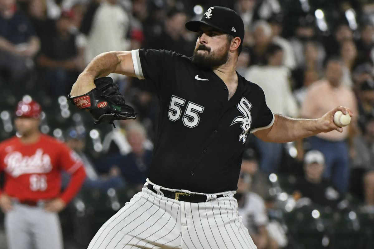 Chicago White Sox starting pitcher Carlos Rodon (55) throws a pitch during the first inning against the Cincinnati Reds at Guaranteed Rate Field.