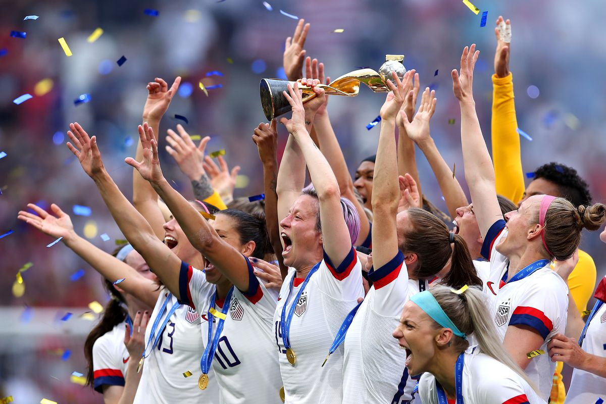 Megan Rapinoe of the U.S. women's soccer team lifts the FIFA Women's World Cup Trophy after the team's championship victory on Sunday in France.