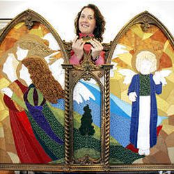 Jennifer Jensen shows off the panels she made that will be part of her display at the Festival of Trees, which runs Nov. 30-Dec 3 at the South Towne Expo Center.