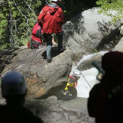 Members of the Salt Lake County Search and Rescue team join with the Unified Police Department and the Utah Department of Public Safety in an effort to recover the body of a 22-year-old hiker who fell in Bell Canyon on Monday, June 5, 2017. Siaosi Brown's body was spotted in the lower falls of the canyon. His body was trapped on some logs in the middle of the waterfall, Unified Police Lt. Brian Lohrke said.